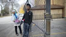 Fatima Animer, 16, and her brother Moubachar Animer, 14, are photographed in their Regent Park neighbourhood in Toronto, Ont. Nov. 15, 2010. (Kevin Van Paassen/The Globe and Mail/Kevin Van Paassen/The Globe and Mail)