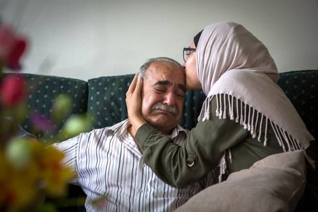 Mohamed Sharbaji gets a hug from his daughter Sedra, after he tells her his dream for her is that she can 'look up at the sky and feel happy.' Once an elected official in a neighbourhood in Aleppo, Syria, Mr. Sharbaji now lives in Saint John. His daughter, who picked up English quickly, is now his main lifeline to the outside world.