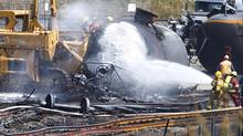 Crews work in the area of the derailed tanker cars in Lac-Mégantic, Que., on July 14, 2013. (PETER POWER/THE GLOBE AND MAIL)