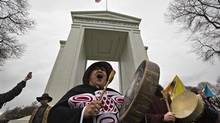 Native protesters chant during an Idle No More march at the Peace Arch border crossing between Canada and the United States in Surrey, B.C. (ANDY CLARK/REUTERS)