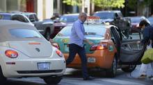 People who stop their cars in the curb lane during rush hour to pick up a passenger are rude. (Fred Lum/The Globe and Mail)