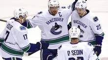 Vancouver Canucks' Alexander Edler (23), celebrates his goal against the Phoenix Coyotes with teammates Henrik Sedin (33), Ryan Kesler (17), and Daniel Sedin (22) during the first period, Feb. 28, 2012, in Glendale, Ariz. (Ross D. Franklin/The Associated Press/Ross D. Franklin/The Associated Press)
