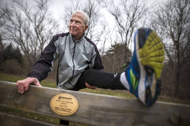 Earl Fee stretches on a Mississauga bench that was donated in his name.