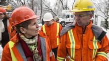 Anthony Haines, right, seen with Kathleen Wynne, says there is 'no perfect answer' to preventing future outages. (Chris Young/THE CANADIAN PRESS)