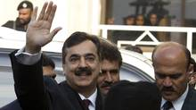 Pakistani Prime Minister Yousuf Raza Gilani waves upon his arrival at the Supreme Court in Islamabad on Jan. 19, 2012. (B.K.Bangash/AP/B.K.Bangash/AP)