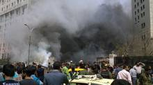 This photo released by the Syrian official news agency SANA, shows smoke rising from burned cars after a huge explosion shook the Sabaa Bahrat Square, one of the capital's biggest roundabouts, in Damascus, on Monday, April. 8, 2013. (HOPD/Associated Press)