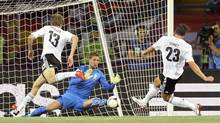 Germany's Mario Gomez (R) scores a goal against Netherlands during their Group B Euro 2012 soccer match at the Metalist stadium in Kharkiv, June 13, 2012. (THOMAS BOHLEN/REUTERS)