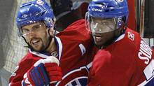 Montreal Canadiens' Brian Gionta, left, celebrates his goal with teammate P.K. Subban against the Philadelphia Flyers during third period of Game 3 NHL Eastern Conference final hockey action Thursday, May 20, 2010 in Montreal. A published report in Montreal says forward Brian Gionta will be named the next captain of the Canadiens. (Ryan Remiorz/The Canadian Press/Ryan Remiorz/The Canadian Press)