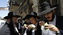 Ultra-Orthodox Jewish men check etrogs, or citrus fruits, in preparation for use in rituals during the Jewish holiday of Sukkot, which begins Wednesday at sundown. (AMMAR AWAD/REUTERS)
