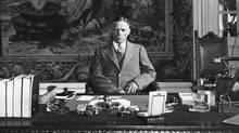 William E. Dodd, U.S. ambassador to Nazi Germany, photographed at his desk in Berlin, July 1933. (Granger Collection)