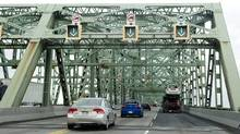 Motorists cross the Champlain Bridge in Montreal on March 18, 2011. (Graham Hughes/THE CANADIAN PRESS)