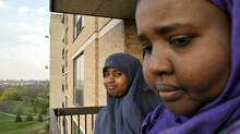 Suad Aimad, right, with her youngest daughter Amal Mohammed, 11, at their Toronto apartment. Ms. Aimad is president of a Muslim education activist group that weighs in on standards of education and opposes liberalizing the teaching of sex education. (J.P. MOCZULSKI/J.P. Moczulski/The Globe and Mail)