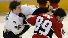 Pittsburgh Penguins' Colby Armstrong (L) fights with Ottawa Senators' Mike Comrie during the third period in Game 2 of NHL's Eastern Conference quarterfinal hockey game in Ottawa April 14, 2007. REUTERS/Shaun Best (SHAUN BEST)
