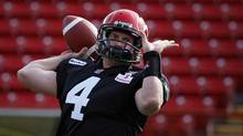 Calgary Stampeders' quarterback Drew Tate throws a ball during the first day of training camp in Calgary, Alta., Sunday, June 3, 2012. (Jeff McIntosh/THE CANADIAN PRESS)