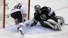 Chicago Blackhawks right wing Patrick Kane scores past Los Angeles Kings goalie Jonathan Quick (Chris Carlson/AP)