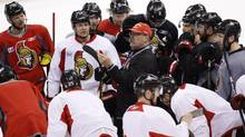 Ottawa Senators coach Paul MacLean talks to the team during practice at Scotiabank Place ahead of game five of their Stanley Cup Eastern Conference semi-final NHL hockey game against the Pittsburgh Penguins in Ottawa on Tuesday, May 21, 2013. (PATRICK DOYLE/THE CANADIAN PRESS)