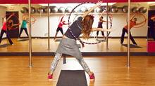 Angela Mahoney leads the Hoola Hoop Fitness class at Sugarfoot fitness studio in Toronto. (Jennifer Roberts for The Globe and Mail)