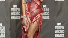 Lady Gaga defended her meat ensemble on The Ellen DeGeneres Show, saying that the outfit was her way of standing up for gay soldier's rights. (MARIO ANZUONI/REUTERS)