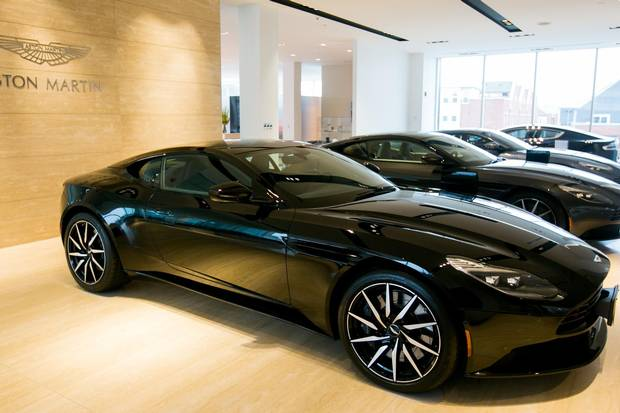 The mandate of fulfilling a consistent brand experience is plainly visible at the Grand Touring dealership, where a variety of luxury brands adhere to strict, brand-specific aesthetic requirements, even within the same showroom.