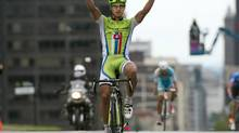Peter Sagan, from Slovakia,celebrates as he crosses the finish line to win the Montreal Cycling Grand Prix, Sunday, September 15, 2013 in Montreal. (RYAN REMIORZ/THE CANADIAN PRESS)