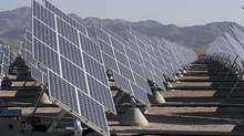 A solar photovoltaic array is seen here at Nellis Air Force Base in Las Vegas, Nevada. The 15 megawatt plant, consisting of 70,000 panels on 140 acres, provides 30 per cent of the base's electricity needs. (STEVE MARCUS/REUTERS/STEVE MARCUS/REUTERS)