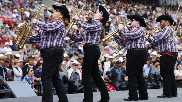 The Calgary Stampede show band plays for fans before the start of the rodeo in Calgary, Alberta, July 5, 2015.
