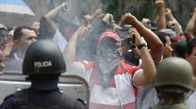 Supporters of Honduras' ousted president Manuel Zelaya yell at soldiers during a march in Tegucigalpa on Tuesday. (TOMAS BRAVO)