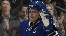 Dion Phaneuf #3 of the Toronto Maple Leafs waves as he is introduced as Captain before playing the Montreal Canadiens during a regular season NHL game against the Toronto Maple Leafs at the Air Canada Centre October 7, 2010 in Toronto, Ontario, Canada. (Abelimages/2010 Getty Images)