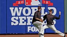 San Francisco Giant Jeremy Affeldt, right, and Javier Lopez warm up before the World Series against the Detroit Tigers on Wednesday, Oct. 24, 2012, in San Francisco. (Marcio Jose Sanchez/Associated Press)