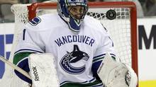 Vancouver Canucks goalie Roberto Luongo keeps his eyes trained on a rebound after a shot from the Dallas Stars in the first period of an NHL game, Thursday, Dec. 19, 2013, in Dallas. (Tony Gutierrez/AP)