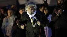 Beppe Grillo appeals to non-aligned voters weary of political corruption and a broken judiciary. <137>Five-Star Movement activist and comedian Beppe Grillo speaks during a rally in Pomezia, near Rome January 23, 2013. REUTERS/Tony Gentile (ITALY - Tags: POLITICS) - RTR3CV01<252><137> (Tony Gentile/Reuters)