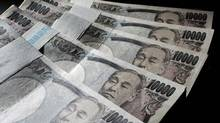 Japanese 10,000 yen bank notes are spread out at an office of World Currency Shop in Tokyo. (YURIKO NAKAO/YURIKO NAKAO/REUTERS)
