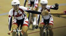 Canada's team members Laura Katherine Brown, Jasmin Glaesser and Stephanie Roorda, celebrate after winning gold medal against Cuba in cycling wome's team pursuit final event at Pan American Games in Guadalajara, Mexico, Tuesday, Oct. 18, 2011. (Jorge Saenz/Associated Press)