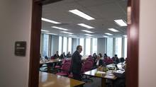 Officials representing the B.C. Teachers' Federation and the B.C. Public School Employers Association await the start of a Labour Relations Board hearing over lockout provisions in Vancouver on May 29, 2014. (John Lehmann/The Globe and Mail)
