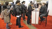 Hundreds line up for various booths at a job fair in Toronto earlier this year. Canada's youth jobless rate rose to 14.8 per cent last month, and employment levels are lower than a year ago – despite sturdy job growth among other age groups in the country. (J.P. MOCZULSKI For The Globe and Mail)