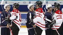 Canada's players shake hands with players of the U.S. following their semi-final game at the 2013 IIHF U20 World Junior Hockey Championship in Ufa January 3, 2013. (Reuters)