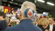 A Conservative Party supporter waits for Stephen Harper to speak at a campaign stop in Saskatoon on April 15, 2011. (DAVID STOBBE/REUTERS)