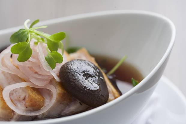 Pork belly with warm dashi broth, shiitake, pea greens, and pickled shallots.