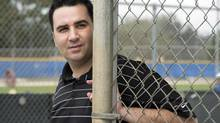Toronto Blue Jays GM Alex Anthopoulos keeps an eye on the action at Spring Training in Dunedin, Fla. on February 21, 2014. The Blue Jays had been in the mix for Ervin Santana with several Toronto players making a public plea to sign the 33-year-old former all-star. But Santana elected to sign with the injury-ravaged Atlanta Braves. (Frank Gunn/THE CANADIAN PRESS)