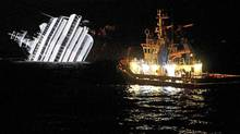 A tugboat approaches the wreck of the Costa Concordia as preparations are made to remove fuel from the stricken cruise ship. (MAX ROSSI/MAX ROSSI/REUTERS)