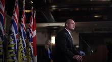 Minister of Finance and House Leader, Hon. Mike de Jong speaks to media following Premier Christy Clark's announcement of a cabinet renewal of 16 ministers and two ministers of state at the Government House in Victoria on Wednesday Sept. 5, 2012. (CHAD HIPOLITO/THE CANADIAN PRESS)