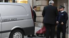 A stretcher is brought from a private ambulance into the block of flats where the nurse Jacintha Saldanha lived near the King Edward VII Hospital in central London December 7, 2012. A female nurse who took a prank call at the London hospital that treated Prince William's pregnant wife Kate for morning sickness has been found dead, the hospital said on Friday. (Olivia Harris/REUTERS)
