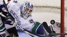 Vancouver Canucks goalie Cory Schneider (35) makes a gove save against the Los Angeles Kings in the second period during Game 4 of their NHL Western Conference Hockey quarter-final playoff in Los Angeles. (DANNY MOLOSHOK/Reuters)