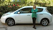 Monica Horan Rosenthal and her Nissan Leaf. (Erin Champion/Erin Champion)
