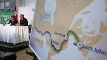 TransCanada CEO Russ Girling (second from left) announces the new Energy East pipeline during a news conference in Calgary. (TODD KOROL/REUTERS)