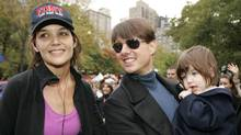 In this Nov. 4, 2007 file photo, actress Katie Holmes joins her husband Tom Cruise as he holds their daughter Suri after Holmes finished the New York City Marathon in New York. Holmes' attorney Jonathan Wolfe said Friday June 29, 2012 that the couple is divorcing, but called it a private matter for the family. (AP Photo/Kathy Willens, file) (Kathy Willens/AP)