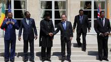 "French President Francois Hollande, third right, shakes hands with Nigeria President Goodluck Jonathan, third left, as others, from left, Niger's President Mahamadou Issoufou, Chad's President Idriss Debi, Cameroon President Paul Biya, Benin president Thomas Boni Yayi, look on for the family picture at the ""Paris' Security in Nigeria summit"", at the Elysee Palace, in Paris on May 17. (Francois Mori/AP)"