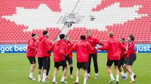 Members of Canada's national men's soccer team practice (Nathan Denette/The Canadian Press)
