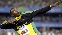 This Sept. 4, 2011 file photo shows Jamaica's Usain Bolt posing on the podium after the Jamaican team won the gold and set a new world record in the men's 4x100m relay final at the World Athletics Championships in Daegu, South Korea. Any talk of the Olympics has to start with the flashy Jamaican sprinter. His performance in Beijing four years ago was magical. (AP Photo/Martin Meissner, FIle) (Martin Meissner/AP)