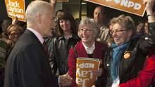NDP Leader Jack Layton is greeted by supporters at a campaign rally at Ecole secondaire du Versant in Gatineau, Que. (Andrew Vaughan/The Canadian Press)